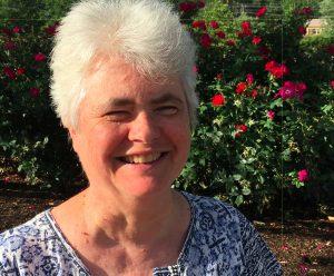 Headshot with roses of Maureen McHugh