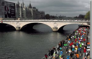 Cherry running the Paris Marathon along the Seine.